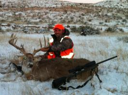 someone with massive buck in snow